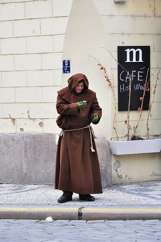 """""""Monk"""" with mobile phone, by palimphread, used under cc license"""